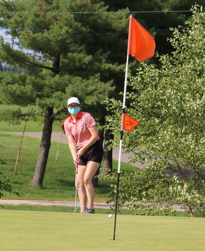 Masked up and ready to go, Lincolnwood's Dorie Krager chips onto the green at the par-5 ninth hole at Shoal Creek Golf Course on Monday, Aug. 17. Krager would go on to take medalist honors with a 48, helping the Lancers to wins over South County and North Mac.