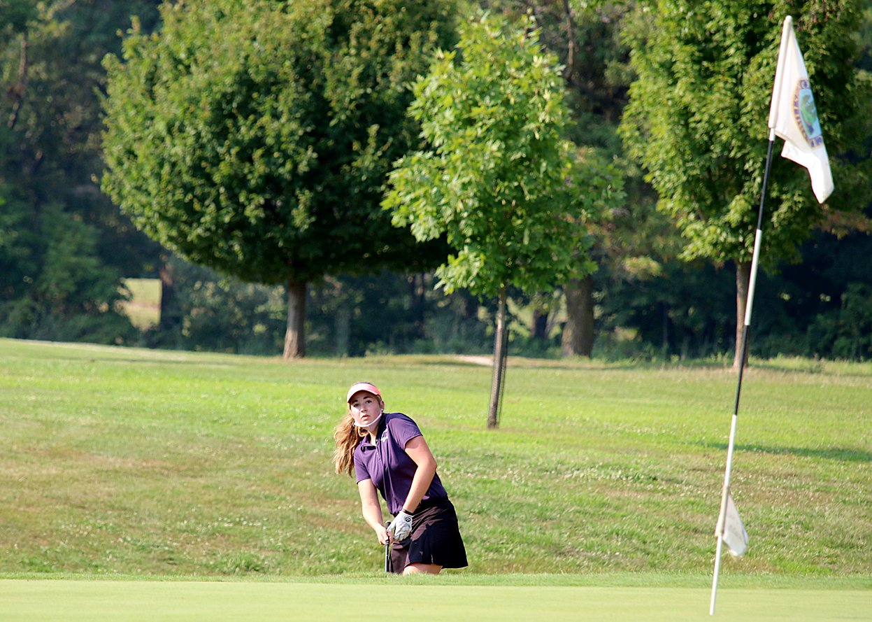 Litchfield's Laura Boston watches as her chip heads toward the number three green at the Hillsboro Country Club on Tuesday, Aug. 25. Boston would shoot a 42 on the day to take medalist honors and lead the Panthers to a win over Hillsboro and Roxana.