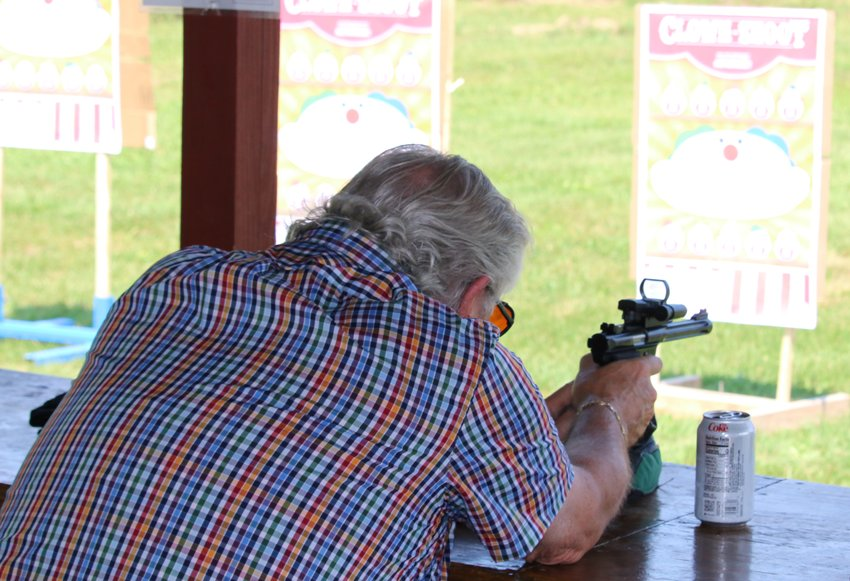 Don Bilyeu takes aim at one of the clown targets during the Litchfield Sportman's Club .22 Fun Shoot on Sunday, Aug. 23. Bilyeu would take the top spot in the first of four rounds, scoring 2,000 points out of a possible 3,000.