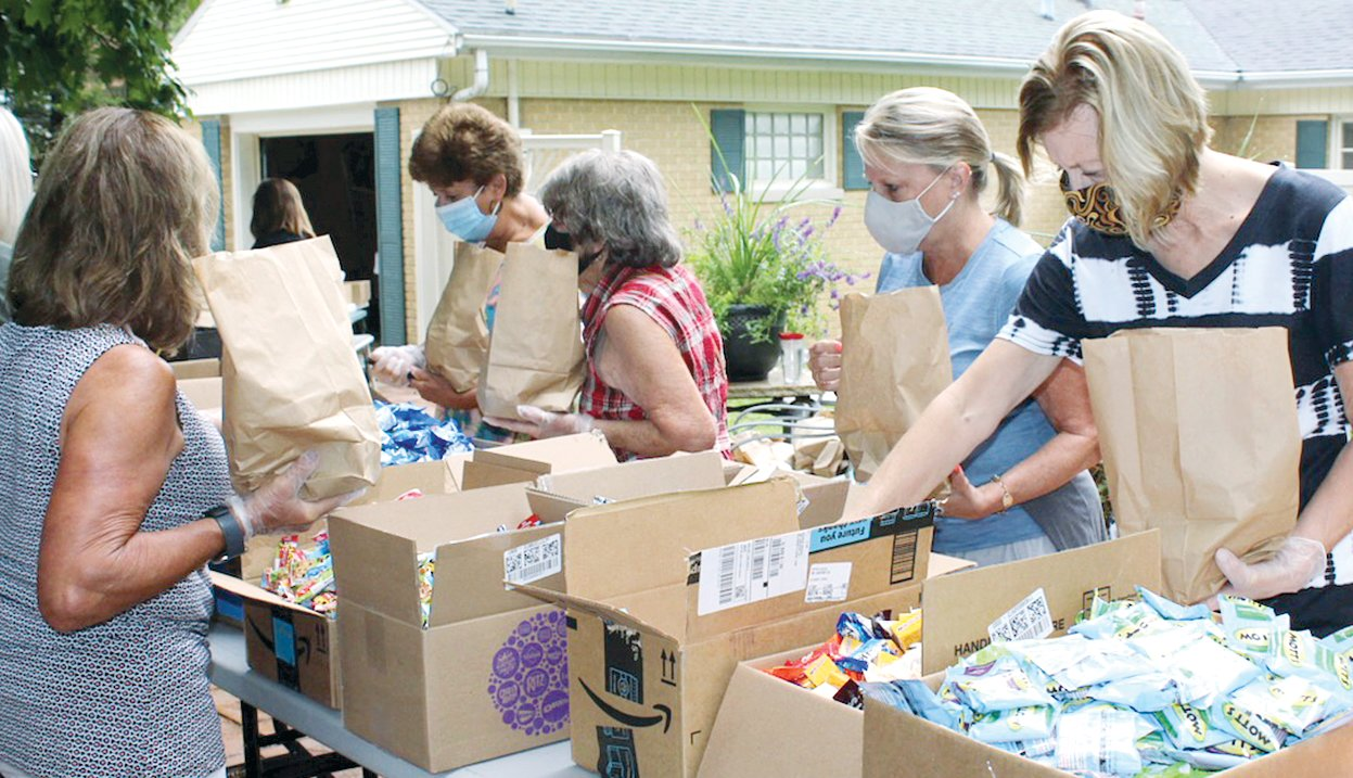 Among those packing treat bags from the left are Donna Youngless, Connie Harling, Sonya Luckett, Karen Donham and Pam Dawson.