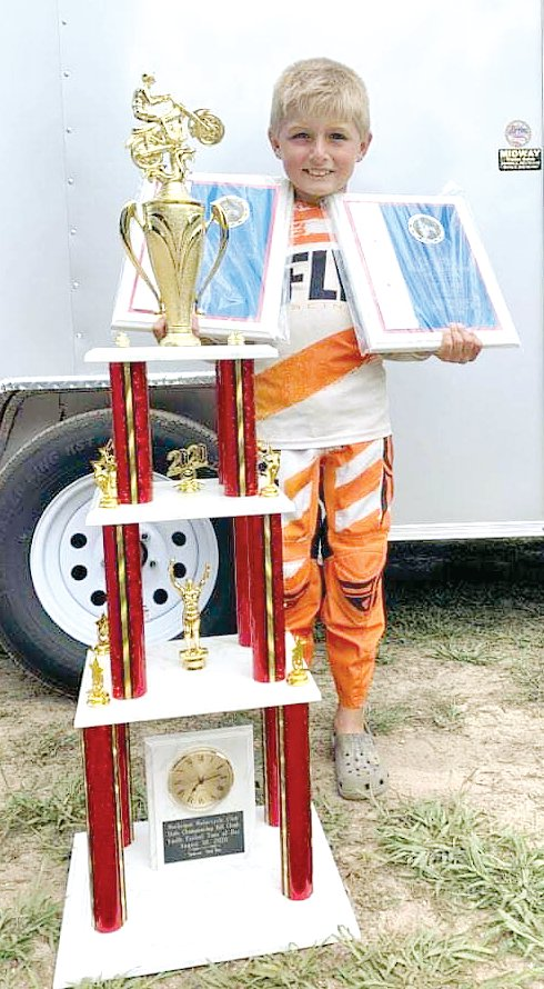 Nine-year-old Cam Bone picked up a trophy nearly taller than he was on Saturday, Aug. 29, for winning the 50cc class at the Michigan State Hillclimb. Bone, the son of Mac and Stacey Bone of Litchfield, is one of the top young hillclimbers in the country, with nationals coming up later this month.