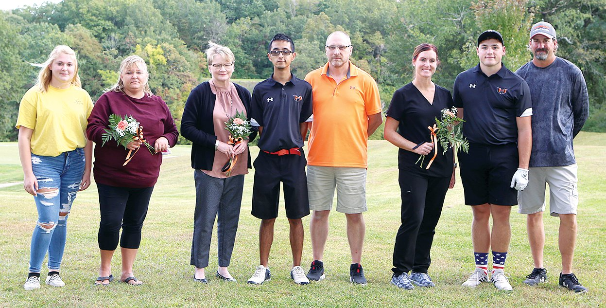 Seniors on the Hillsboro High School golf teams were honored with their parents before the start of the match on Tuesday, Sept. 22, at the Hillsboro Country Club.  Coaches Bob Allen and Jim Luckett introduced each senior and parents, highlighted their high school careers and what each senior intends to do in the future.  From the left are senior Anna Colwell and mother Donna Riggs; mother Shannon Daniels, senior Tad Daniels, and father Tory Daniels; and mother Melody Riggs, senior Shaw Riggs, and father Dave Riggs.