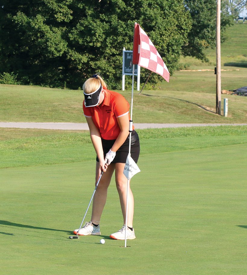 Hillsboro senior Anna Colwell sinks a short putt during the Lady Hiltoppers' match in Staunton on Sept. 21. Colwell shot a 61 on the day, shaving 13 strokes off her score from when the Toppers played at Timber Lakes on Aug. 18.