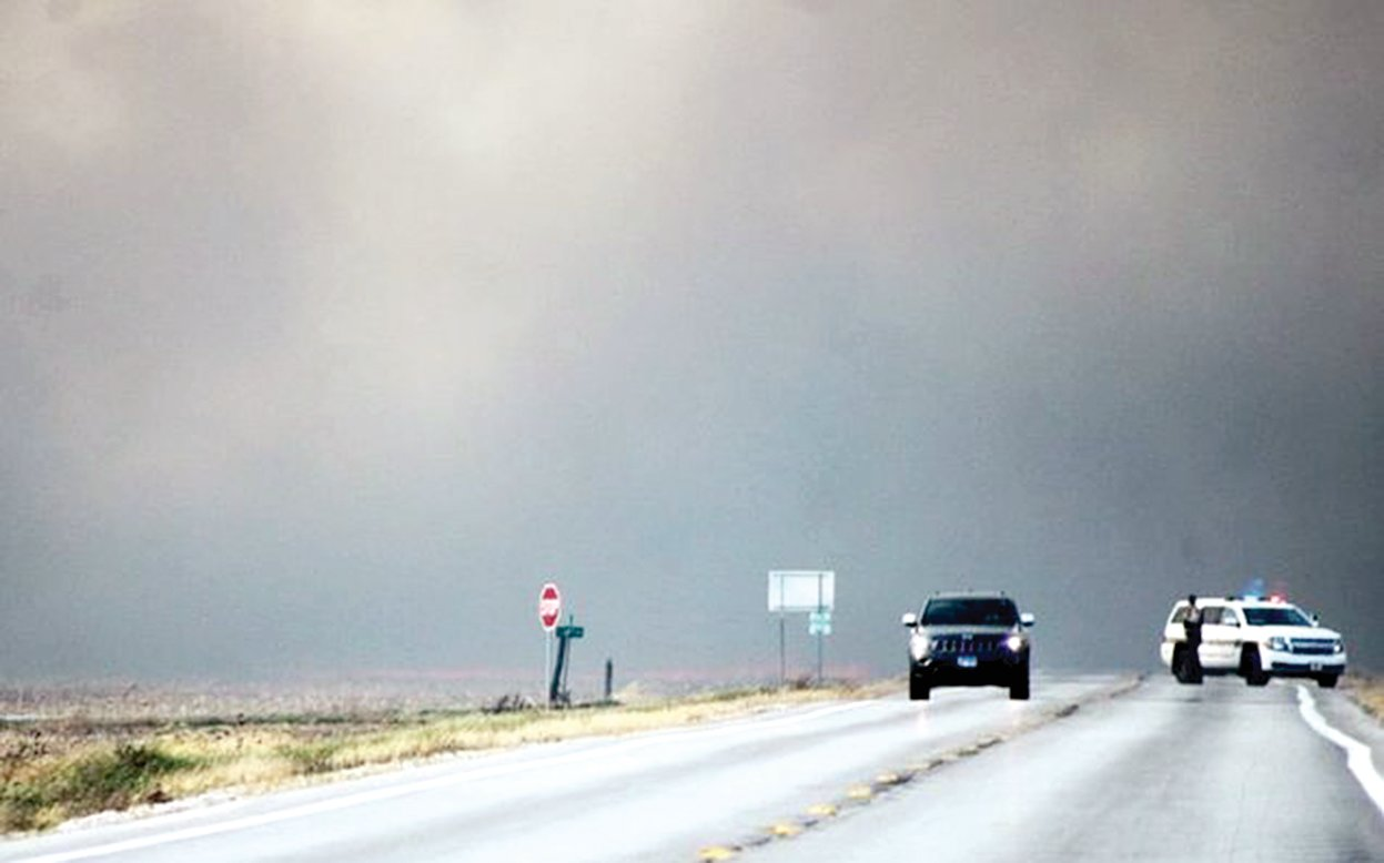 Intense smoke from the fire to the south forced officials to close Route 185 Saturday afternoon.