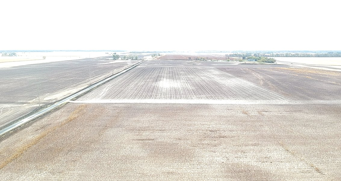 The emptiness in this aerial photo taken Sunday was unharvested standing corn fields before the fire on Saturday.