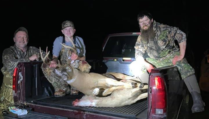 With some help from family friends Brad Saxby (left) and Alex Joyce (right), AJ Sypherd havested his first deer with a bow and arrow, a doe, and his first buck with in five minutes of each other on Sunday, Nov. 1, on the Saxby's land in Litchfield.