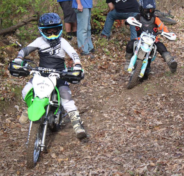 Dax Toberman, left, son of Hillsboro grad Derek Toberman, and Jhenner Walker of Morrisonville make their way around a corner during the Cahokia Creek Dirt Riders Hare Scramble in White City on Sunday, Nov. 8, in White City.