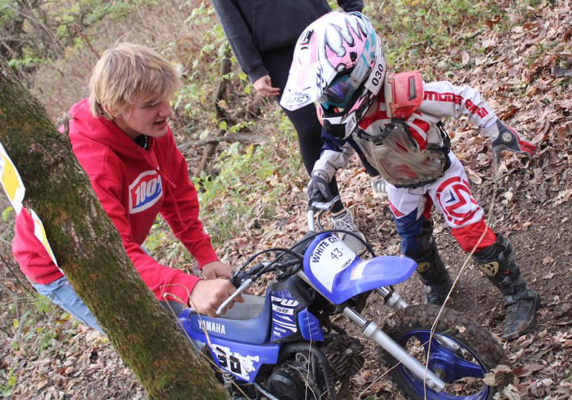 Jhorjie Walker of Morrisonville gets some help from big brother Jhadyn during the 50cc race at the Cahokia Creek Dirt Riders Charity Hare Scramble on Sunday, Nov. 8, in White City. It would be a good day for the Walkers, with Jhorjie finishing seventh and Jhadyn finishing third in the A team race with teammate Skyler Harless. Jhenner (first in 50cc), Jhordyn (11th in 50cc) and Jhak (1st in B team with Gavin Minnaert) also raced on Sunday.