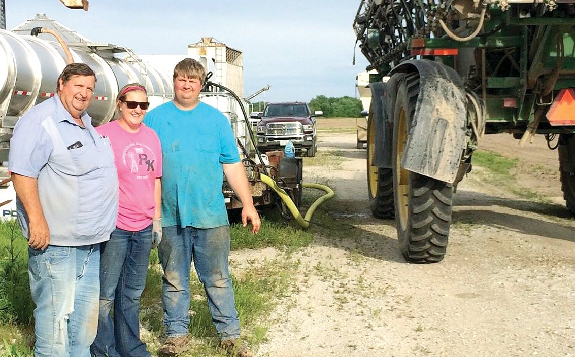 Justison Farms–from the left, David Justison, daughter Patricia Fuchs, and son David Justison, won the Illinois Wheat Association's yield contest this year with an entry of 126.7 bushels per acre.