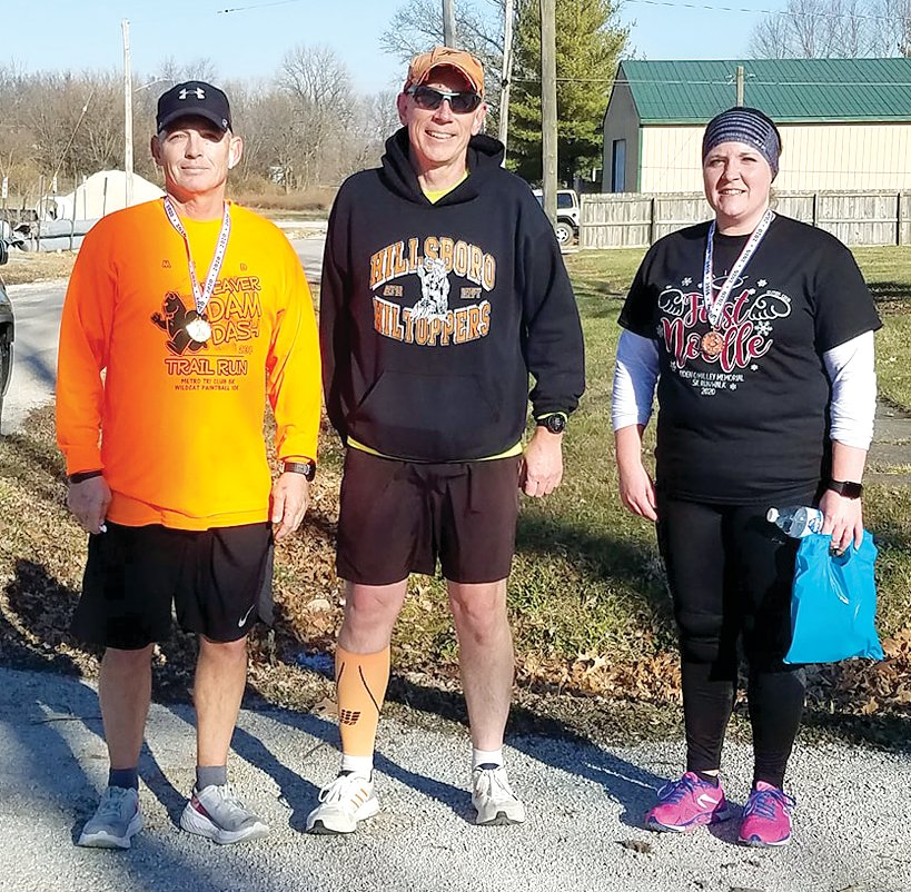 Kurt Hoehn, left, was the overall winner and winner of the adult division at the third annual First Noelle 5K on Saturday, Dec. 5, in Nokomis. Randy Rieke and Rosie McDonald would finish second and third in the adult division of the race, which honored the life of the late Ayden O'Malley.