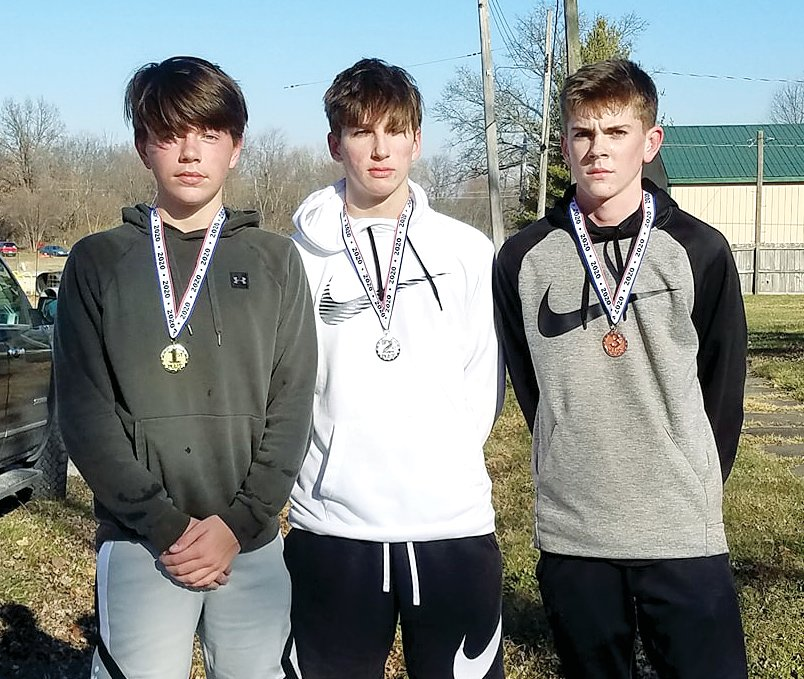 The youth division winners at the third annual First Noelle 5K on Saturday, Dec. 5, in Nokomis, from the left, were Kennedy DeWerff in first place, Elijah Aumann in second place and Ian Keller in third place.