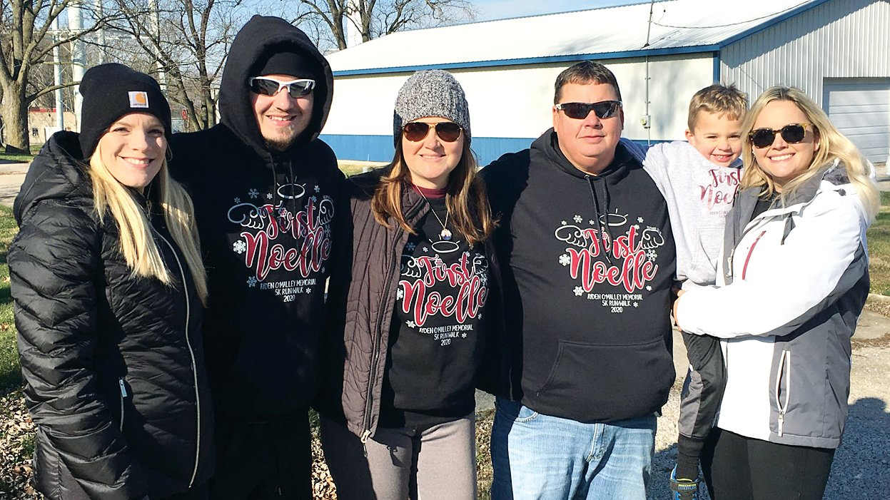Members of Ayden O'Malley's family were on hand for the third annual First Noelle 5K on Saturday, Dec. 5, in Nokomis and handed out thank you bags to all of the participants. From the left, are Kaniesha Hoehn, Nick O'Malley, Roz O'Malley, Den O'Malley and Brody and Amber Wright.
