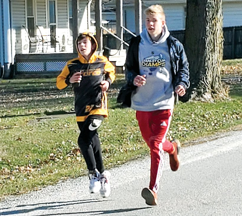 In a spirited race to the finish, Kannon Jonas, left, and Nicholas Harston make their way to the finish line at the third annual First Noelle 5K on Saturday, Dec. 5, in Nokomis.