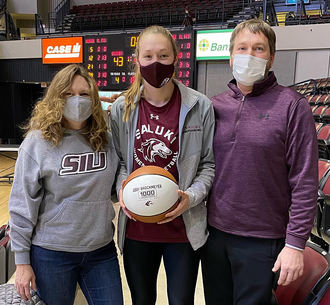 Abby Brockmeyer was recently honored during Southern Illinois University's win over Illinois State on Saturday, Feb. 6, for becoming the 28th member of the Salukis' 1,000 point club. Pictured with Brockmeyer are her parents, Dana and Korey Brockmeyer of Raymond.