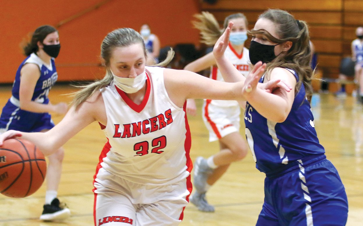Lincolnwood's Katelyn Payne works to find a way around Brussels' Alyssa Kress during the opening minutes of the third quarter of the Lady Lancers' home game on Monday, Feb. 22. Payne would have two points in an early second half run that put the Lancers back into the game, but Brussels finished strong, getting 11 points from Kress in the fourth quarter to escape with a 51-36 win.