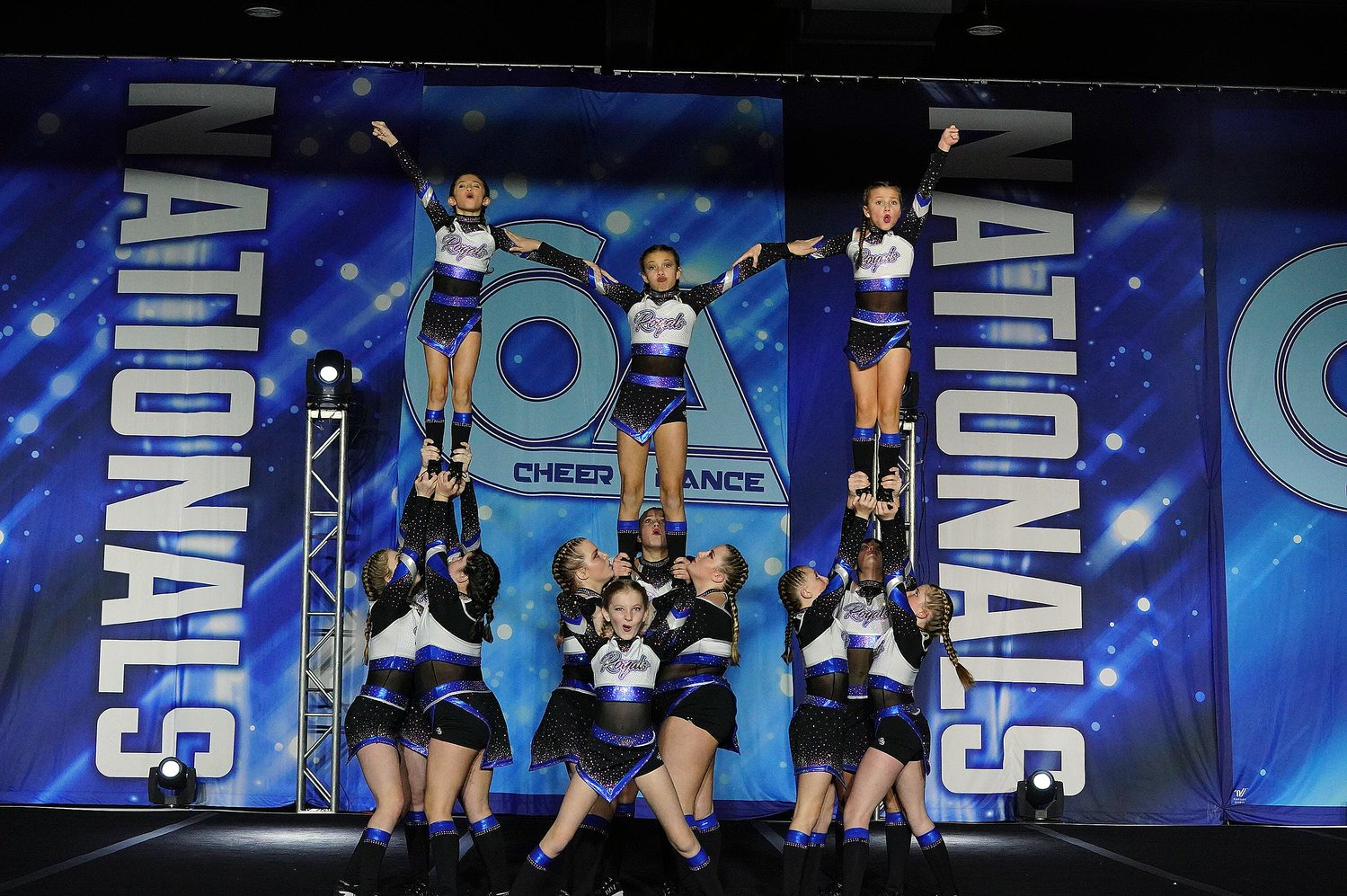 "Above, one of the Midwest Royals' four competitive cheer teams, ""Girl Fight,"" competes at the COA Mid-America Championship in Kansas City, MO."