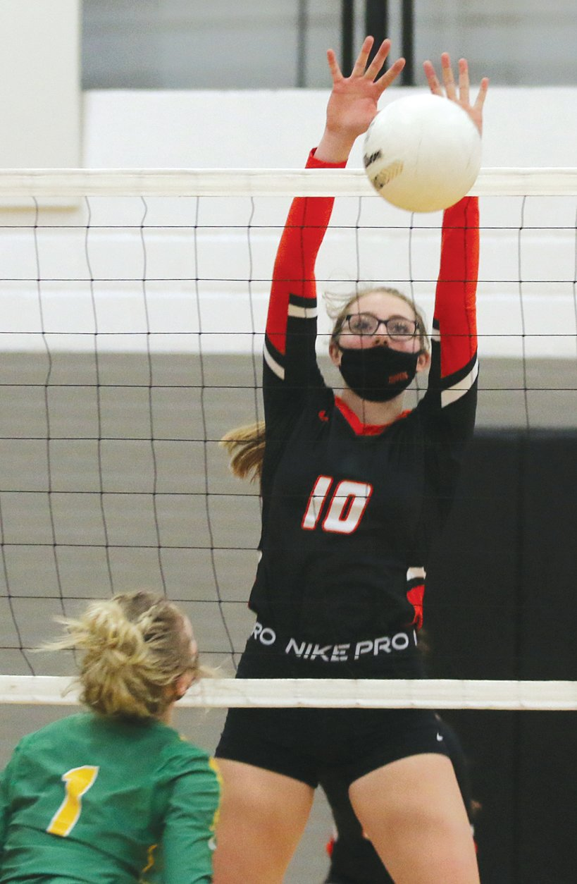 Hillsboro's Kaci Papin was a force at the net for the Toppers, putting down blocks (like the one above) and contributing kills to the Hillsboro attack, including the final two points of the Toppers two-game win over the Piasa Birds of Southwestern on Monday, March 29.