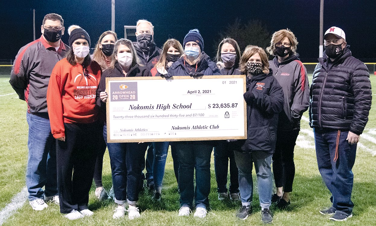 The Nokomis Athletic Club's Arrowhead Open Committee presented a check for $23,635.87 at halftime of the Nokomis football game on Friday, April 2, from the proceeds of the 2020 Arrowhead open. Above, from the left, are Superintendent Dr. Scott Doerr, Beth King, Amy Stolte, Sheila Keller, Brandon Engelman, Tanya Engelman, Dawn Mascher, Liz Engelman, Cassie Watson, Principal Rachelle McDowell and Athletic Director Kevin McDonald. Committee members not present for the photo were Jane Aumann, Bonnie Brownback and Paul Watson.