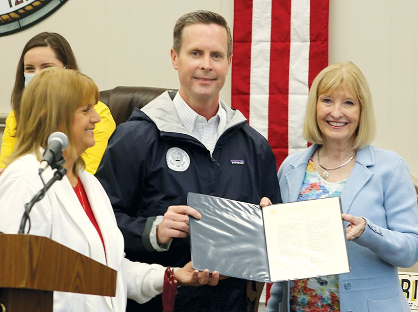 Congressman Rodney Davis, center, presented a copy of the proclamation in honor of Montgomery County's bicentennial read on the floor of the United States House of Representatives to committee co-chairs Donna Yeske, left, and Dr. Patty Whitworth, right.
