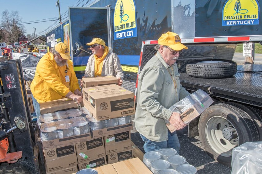 Kentucky Baptist Disaster Relief volunteers unload a tractor-trailer filled with canned goods for a mobile kitchen unit in Shepherdsville, Ky. Kentucky Baptists prepared about 14,000 meals and helped residents in West Point, Ky., clean up flood-damaged homes after the Ohio River flooded in February 2018. (Kentucky Today file photo)