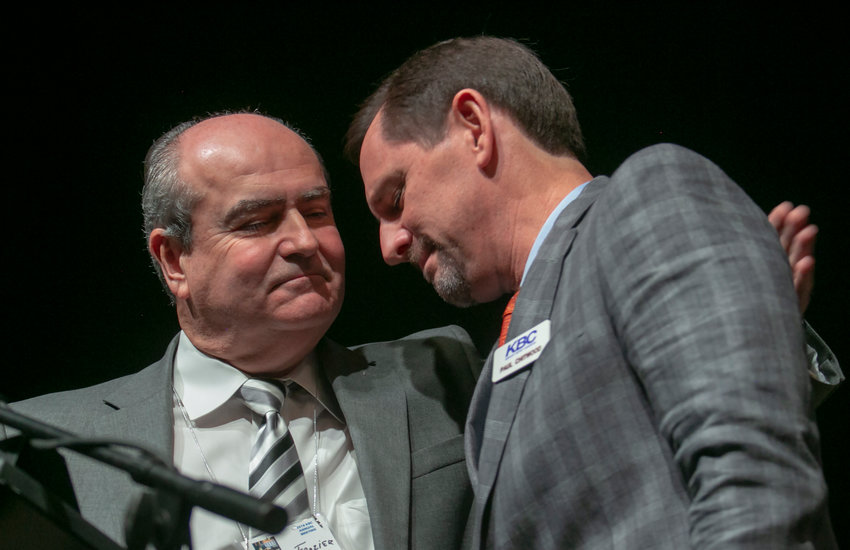 Kentuckian Paul Chitwood, right, receives an embrace from former Kentucky Baptist Convention President Charles Frazier at the KBC Annual Meeting in Pikeville earlier this week after Chitwood announced he was nominated for International Mission Board president. IMB approved Chitwood to lead the world's largest missionary-sending organization on Thursday, Nov. 15, 2018. (Kentucky Today/Robin Cornetet)