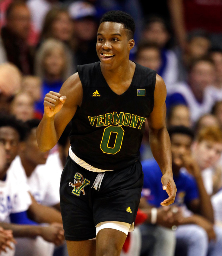 Vermont guard Stef Smith (0) celebrates a basket during the first half of an NCAA college basketball game against Kansas in Lawrence, Kan., Monday, Nov. 12, 2018. (AP Photo/Orlin Wagner)