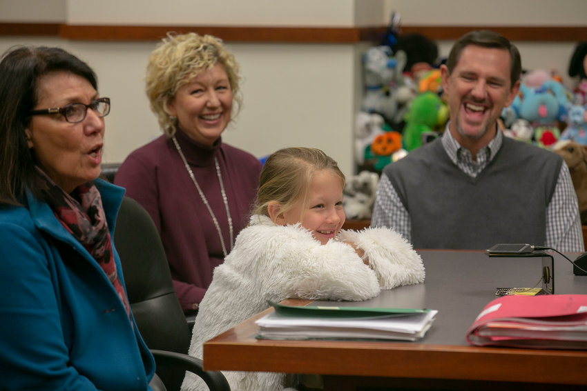 Lilly Chitwood's face lit up when a family court judge officially declared her the daughter of Paul and Michelle Chitwood on Thursday, Dec. 6, 2018, in Louisville, Ky. The Chitwoods had fostered Lilly through Sunrise Children's Services for three years. (Kentucky Today/Robin Cornetet)