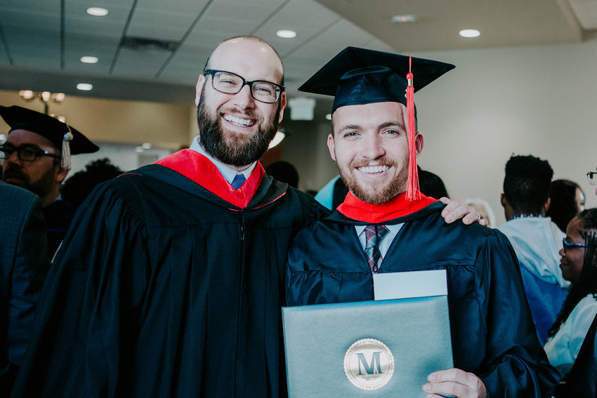 Sam Bierig, dean of Spurgeon College at Midwestern Seminary, celebrates with Chase Roberts, who graduated with an M.Div. degree during MBTS' commencement exercises Dec. 7.