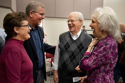 Susan and Todd Lafferty (left) share a warm greeting with IMB President Emeritus Jerry Rankin and his wife, Bobbye, following the IMB trustees' plenary session Feb. 7 in Richmond, Va. Lafferty was unanimously elected as the IMB's executive vice president during the session. (IMB / Chris Carter)