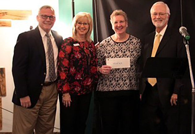 WMU Foundation recently gave more than half a million dollars to national Woman's Missionary Union, a gift earmarked to help the organization carry on its vital missions work. Pictured are (left to right) David George, WMU Foundation president; Linda Cooper, WMU national president; Sandy Wisdom-Martin, WMU executive director-treasurer; and James Wright, WMU Foundation board chair.