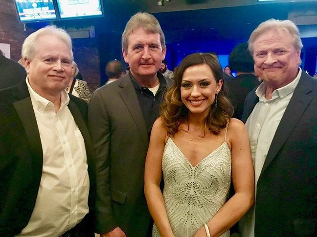 """Kentucky native Gary Gentry, right, attending the premiere of """"Unplanned"""" in Los Angeles. He is pictured with Ashley Bratcher, the star of the movie, and Richard Young and Roy Martin, who along with Gentry comprise the leadership of the promotion team for this Christian film. (Submitted photo)"""