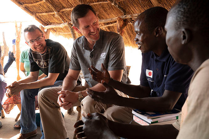 IMB President Paul Chitwood (center) sits with missionary Kevin Singerman and Geofrey Ochan of Hope Baptist Church in Arua, Uganda. Chitwood visited the refugee camp as part of his visit around Uganda to see the ministry firsthand, as well as encourage IMB missionaries and meet with national partners. (IMB / Chris Carter)