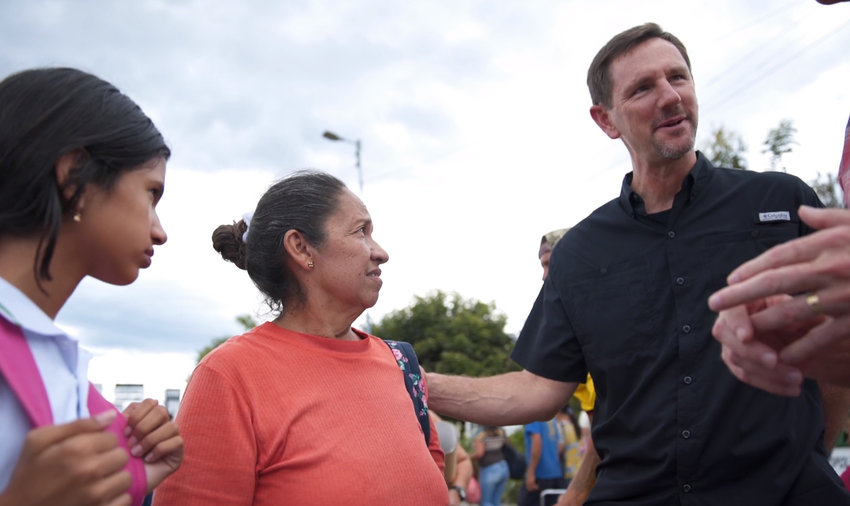 """International Mission Board President Paul Chitwood visited with refugees along the Venezuelan border. """"We're thankful that Southern Baptists are here ministering to the needs of people who really are in a desperate situation."""" (Screen capture from IMB video)"""