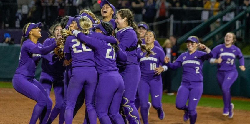 Washington players celebrate after completing a two-game sweep of Kentucky in the Super Regionals early Sunday morning. (Washington Athletics Photo)
