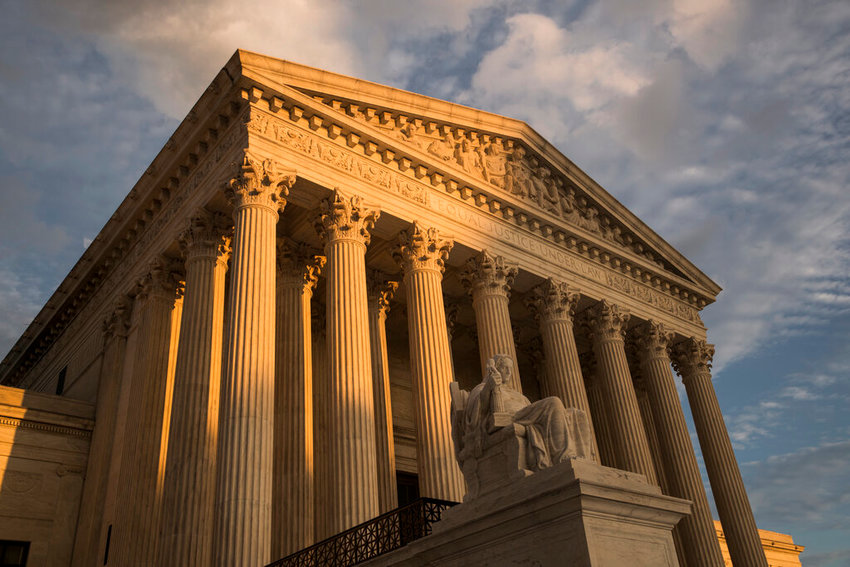 In this Oct. 10, 2017, file photo, the Supreme Court in Washington, at sunset. The Supreme Court is upholding an Indiana law that requires abortion providers to dispose of aborted fetuses in the same way as human remains. But the justices are staying out of the debate over a broader provision that would prevent a woman in Indiana from having an abortion based on gender, race or disability. (AP Photo/J. Scott Applewhite, File)