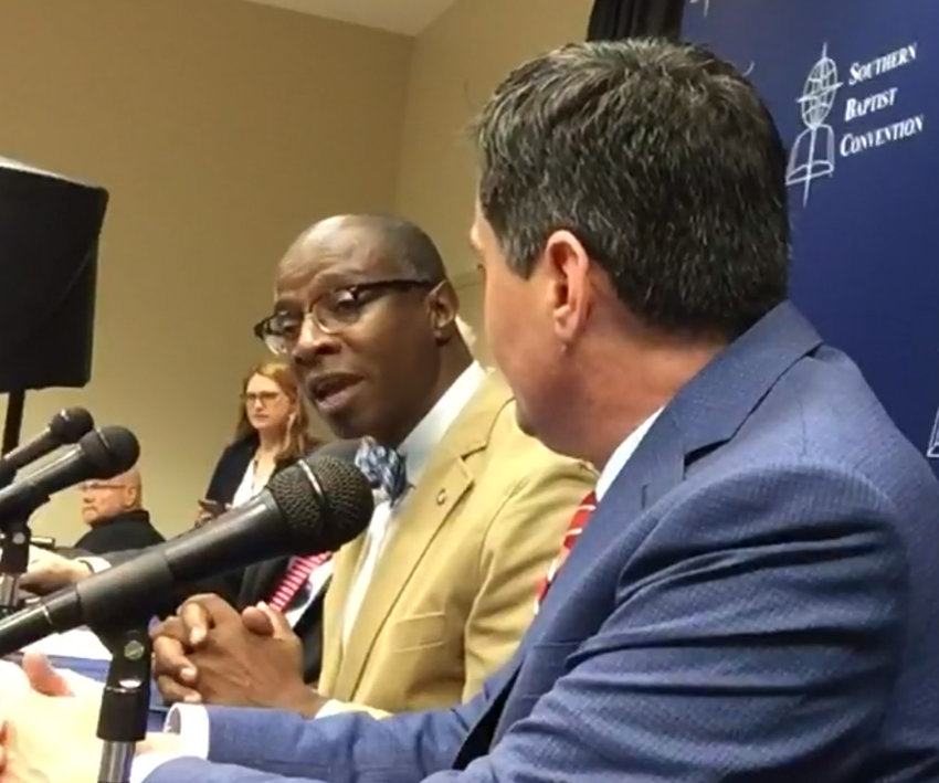 Curtis Woods, co-interim executive director of the Kentucky Baptist Convention, is the chairman of the Resolutions Committee at the Southern Baptist Convention. He answers a question at a press conference with Russell Moore at right. (Screenshot from Baptist Press video)