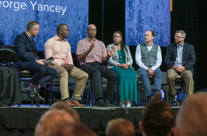 "George Yancey, author, speaks during a panel called ""Undivided: Your Church and Racial Reconciliation"" June 11 during the 2019 Southern Baptist Convention (SBC) annual meeting at the Birmingham-Jefferson Convention Complex in Birmingham, Ala. Other panelists included (left to right): J.D. Greear, president of the SBC and pastor of The Summit Church in Durham, N.C.; Dhati Lewis, pastor of Blueprint Church; Yancey; Missie Branch, assistant dean of students to women at Southeastern Baptist Theological Seminary; James Merritt, pastor of Cross Pointe Church in Duluth, Ga.; and Marshall Blalock, pastor of First Baptist Church in Charleston, S.C. (Photo by Van Payne)"