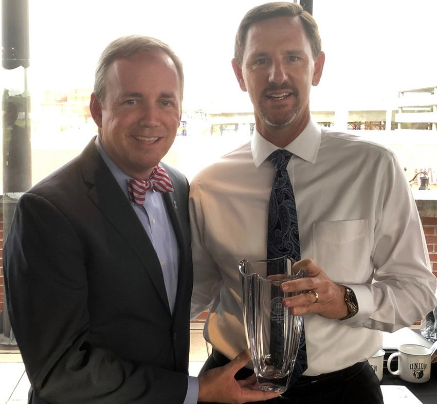 """Paul Chitwood (right), president of the International Mission Board, was the recipient of Union University's M.E. Dodd Denominational Service Award this year. Union President Samuel W. """"Dub"""" Oliver presented the award to Chitwood earlier this month at Union's alumni and friends dinner during the Southern Baptist Convention annual meeting in Birmingham, Ala. (Submitted photo)"""