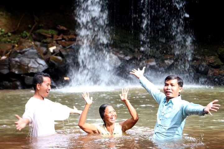 A new believer in Southeast Asia celebrates as she is baptized. IMB workers William and Nancy Potter (names changed) had the opportunity to witness baptisms of third-generation believers in the Southeast Asian church they've been a part of for many years. (IMB Photo)