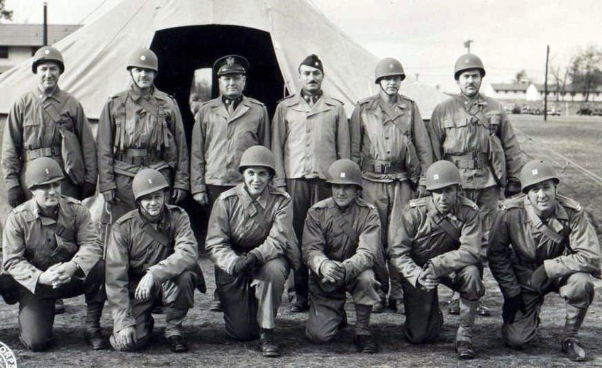"""Southern Baptist chaplain John G. Burkhalter (first row, left), who was in the initial wave of Allied soldiers landing at Omaha Beach, recounted that he """"prayed so hard, especially as I saw those suffering men (my men) scattered here and there and seemingly everywhere in front of me."""" (Arlington Cemetery photo)"""