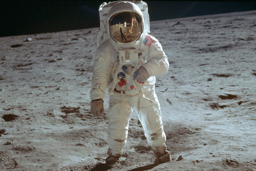 In this July 20, 1969 photo made available by NASA, astronaut Buzz Aldrin, lunar module pilot, walks on the surface of the moon during the Apollo 11 extravehicular activity. (Neil Armstrong/NASA via AP)
