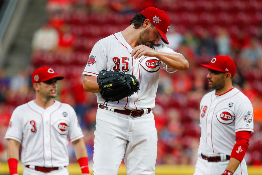 Cincinnati Reds starting pitcher Tanner Roark (35) waits to be relieved in the fourth inning of a baseball game against the Pittsburgh Pirates, Tuesday, July 30, 2019, in Cincinnati. (AP Photo/John Minchillo)