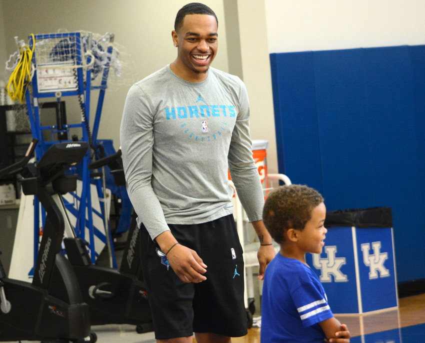 PJ Washington shares a laugh with a camper during a camp Thursday at the Joe Craft Center. Washington was joined by former teammate Reid Travis. Tyler Herro and Keldon Johnson took part in the afternoon portion of the camp. (Kentucky Today/Keith Taylor)