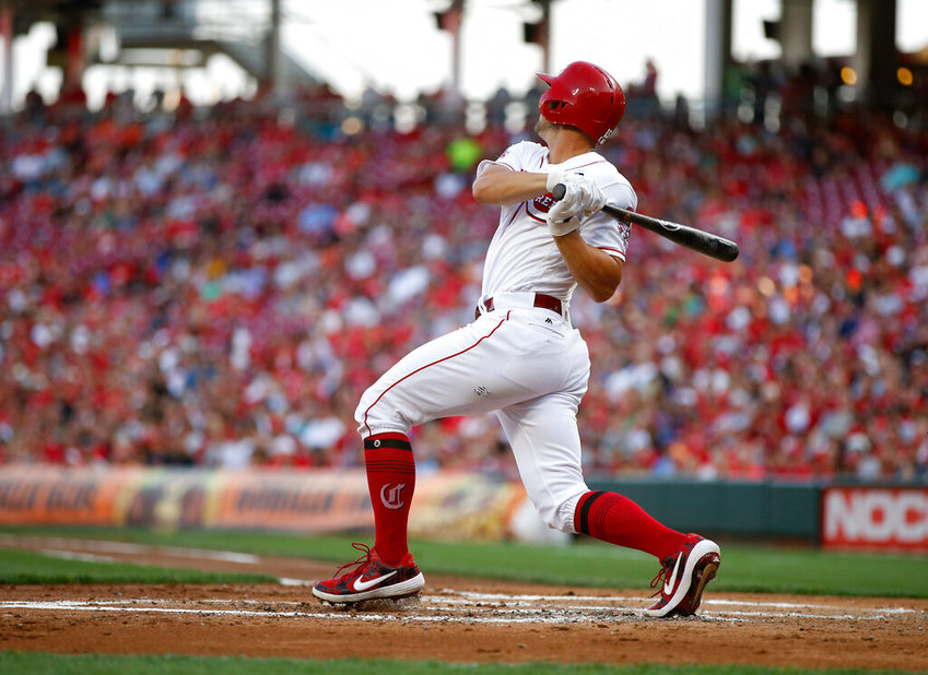 Cincinnati Reds' Nick Senzel hits a two-run single off Los Angeles Angels relief pitcher Taylor Cole during the first inning of a baseball game, Monday, Aug. 5, 2019, in Cincinnati. (AP Photo/Gary Landers)