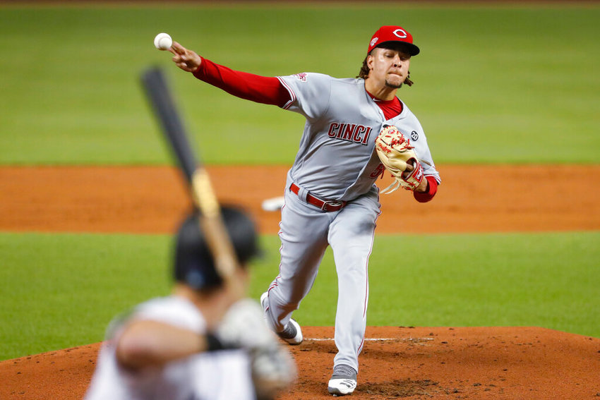 Cincinnati Reds' Luis Castillo pitches to Miami Marlins' Jon Berti during the first inning of a baseball game Tuesday, Aug. 27, 2019, in Miami. (AP Photo/Wilfredo Lee)