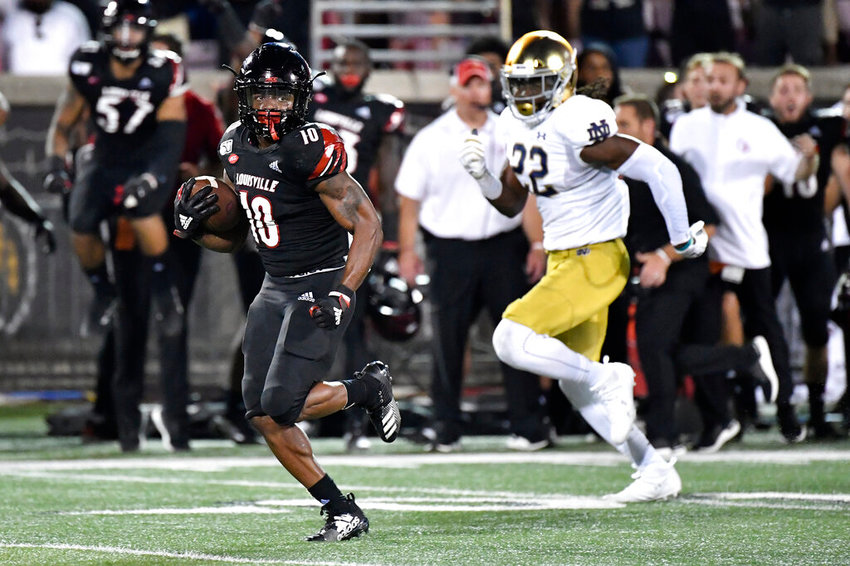 Louisville running back Javian Hawkins (10) runs from the pursuit of Notre Dame linebacker Asmar Bilal (22) during the first half of an NCAA college football game in Louisville, Ky., Monday, Sept. 2, 2019. Notre Dame won 35-17. (AP Photo/Timothy D. Easley)