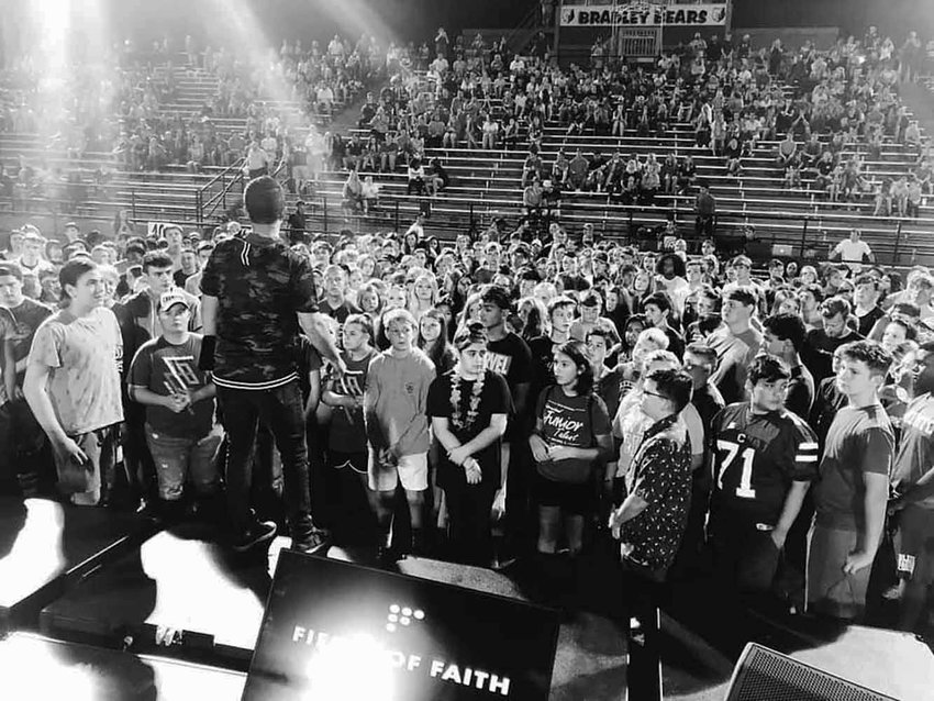 Thousands of middle school and high school students gathered Sept. 25 for an evening of worship and revival at Bradley County High School's football field in Cleveland, Tenn. By the end of the night, ministry leaders reported, about 150 students made professions of faith in Christ. Twitter photo