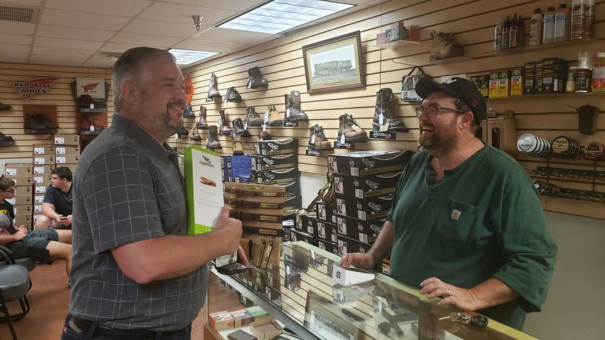 Farmdale Baptist Church Pastor Steve Weaver, left, was the first customer in John Lawrence's new Shoe Magic location in Shelbyville, Ky., recently. (Steve Weaver's Facebook page)