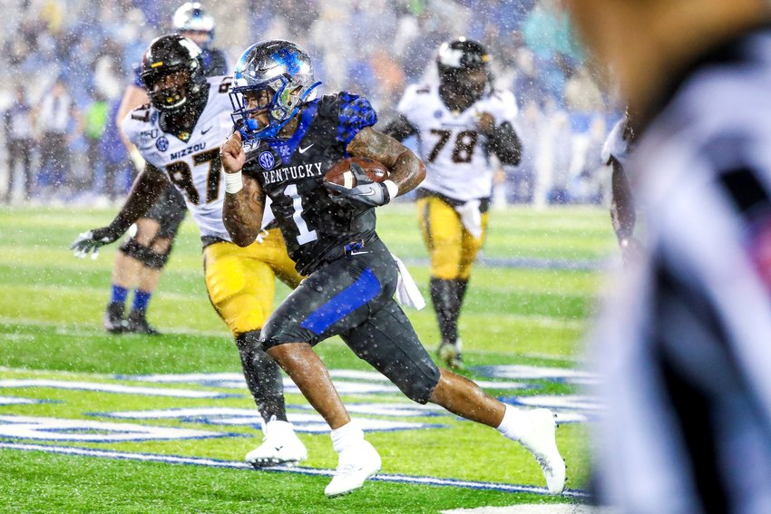 Lynn Bowden makes a dash to the end zone in a downpour during the Wildcats' 29-7 win over Missouri last weekend at Kroger Field. (UK Athletics Photo)