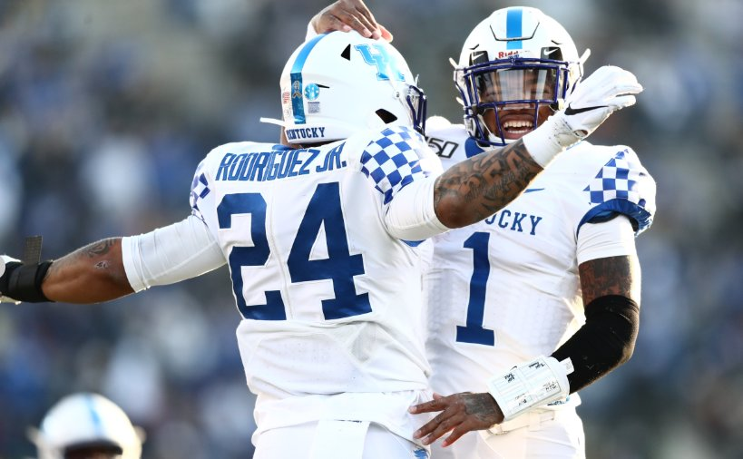 Lynn Bowden, right, and Chris Rodriguez celebrate during Kentucky's 38-14 win over Vanderbilt Saturday in Nashville. The win improved the Wildcats to 5-5 on the season with two games remaining. (UK Athletics Photo)